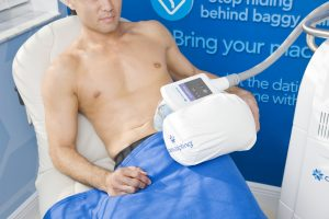CoolSculpting treatment on male patient's abdomen